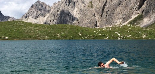 Frank swimming in mountain lake